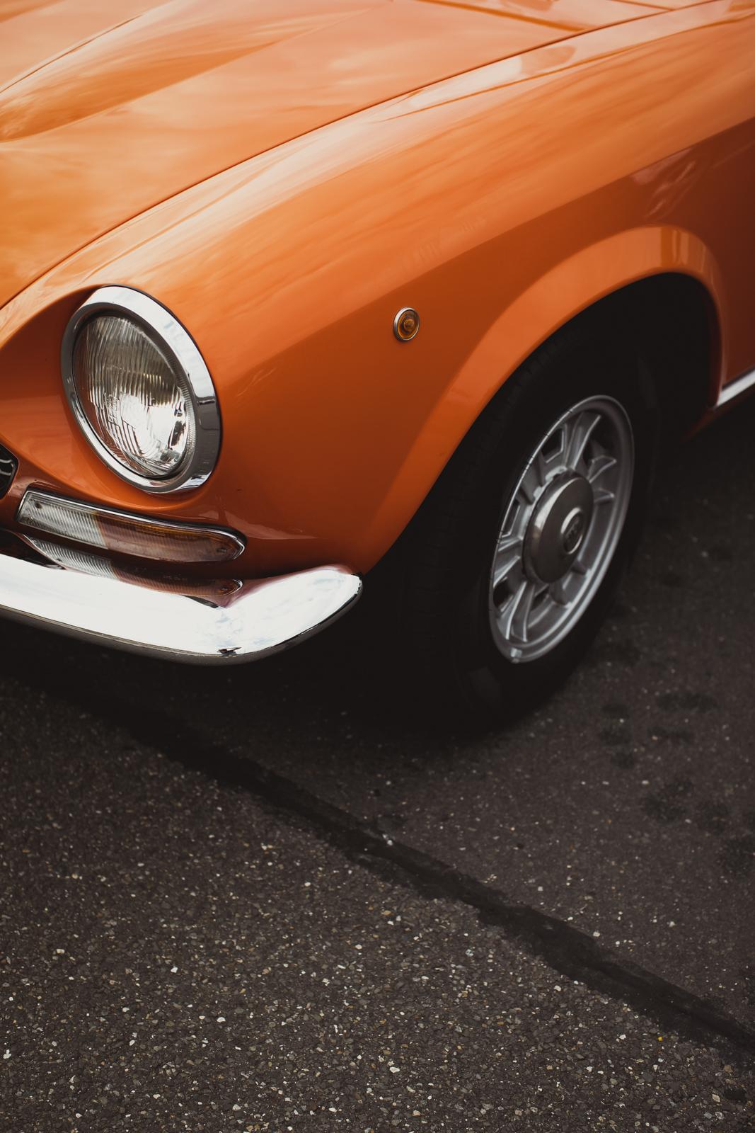 Orange convertible cabrion italian Fiat Spider 124 CS1 (1973)